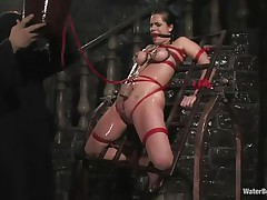 Mia Bangg is bound and gagged in the dungeon where her torturer sprays her nipple-clamped tits. He asks if she wants to get fucked and she does, but 1st this guy gives her a little greater amount pain by pulling tight the rope that splits her pussy lips and smacks her pussy before using a sextoy on her.