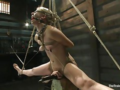 Chastity Lynn is a golden-haired milf who enjoys being fastened up with ropes. She likes when that babe is not able to move her hands and feet freely. As that babe stands helpless with a ball gag in her face hole and a rope blindfold on her eyes, a friend is giving her a large time pleasure, rubbing her wet crack with a vibrator.