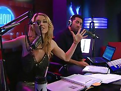 Playboy Radio's Morning Show has some of the hottest hotties you've ever seen! They're talking about Halloween costumes, and their guest has a cop outfit on that looks hawt as hell. It gets even sexier when her top comes off, baring her tits. The female host comes over and helps shorten the skirt.