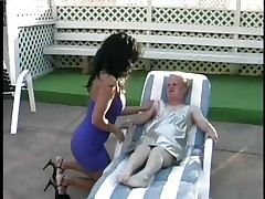 Meet Joey the Midget, the favourable dwarf who receives his shlong wrapped by the lips of that hot brunette playgirl Lamia. See how this babe is treating his hard large cock and sucking it with all her heart as Joey is lying on that chair by the swimming area. Licking, jerking and sucking really makes Joey happy.