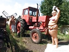 Melinda is so much woman this babe needs 2 men to fuck her. Tibor and Gabor lift up her chubby folds and widen her ass cheeks. The both suck on her huge melons outside by the tractor. The rubs every part of her big chubby beautiful body.