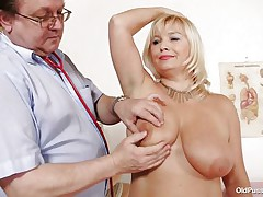 This blonde floozy is completely naked at the doctor. The doctor begins examining her large breasts with large and hawt nipples. After that that guy takes her pulse. The older women is sitting on the bed now with her large a-hole at the doctor. That guy start inspects her a-hole and large shaved vagina from behind.