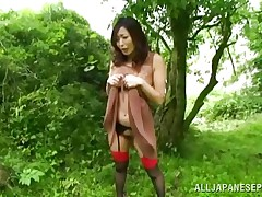 Nature loving Nippon gal is receiving her dose of wilderness! This cute bitch has her hands tied on a tree branch and gets roughly fucked from behind. Her moans and screams won't help her 'cuz there's nobody around. Look at that sweet snatch being rubbed with a vibrator and then fucked hard.