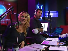 The hosts of Playboy Radio's Morning Show are looking at their guest model who is wearing the costume she'll be wearing to the Playboy Mansion for Halloween. Her head and tits are overspread in fake fruit like oranges, limes, lemons, and more. She flashes her pointer sisters for the hosts and viewers.