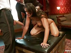 Dark brown wench Penny is a slave at a sex party. This honey is made to suck hard cocks, then gets her wazoo spanked. A large vibrator will solve the situation very well, making her cunt so wet and hot. The guy sticks his dick in her pussy from behind, but she wants to suck some more and begins sucking the dildo!