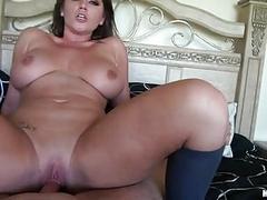 Sensual brunette milf with big balloons rides hard weiner in bedroom