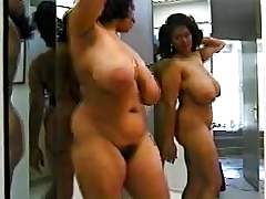 Darksome woman with amazing body dancing in mirror